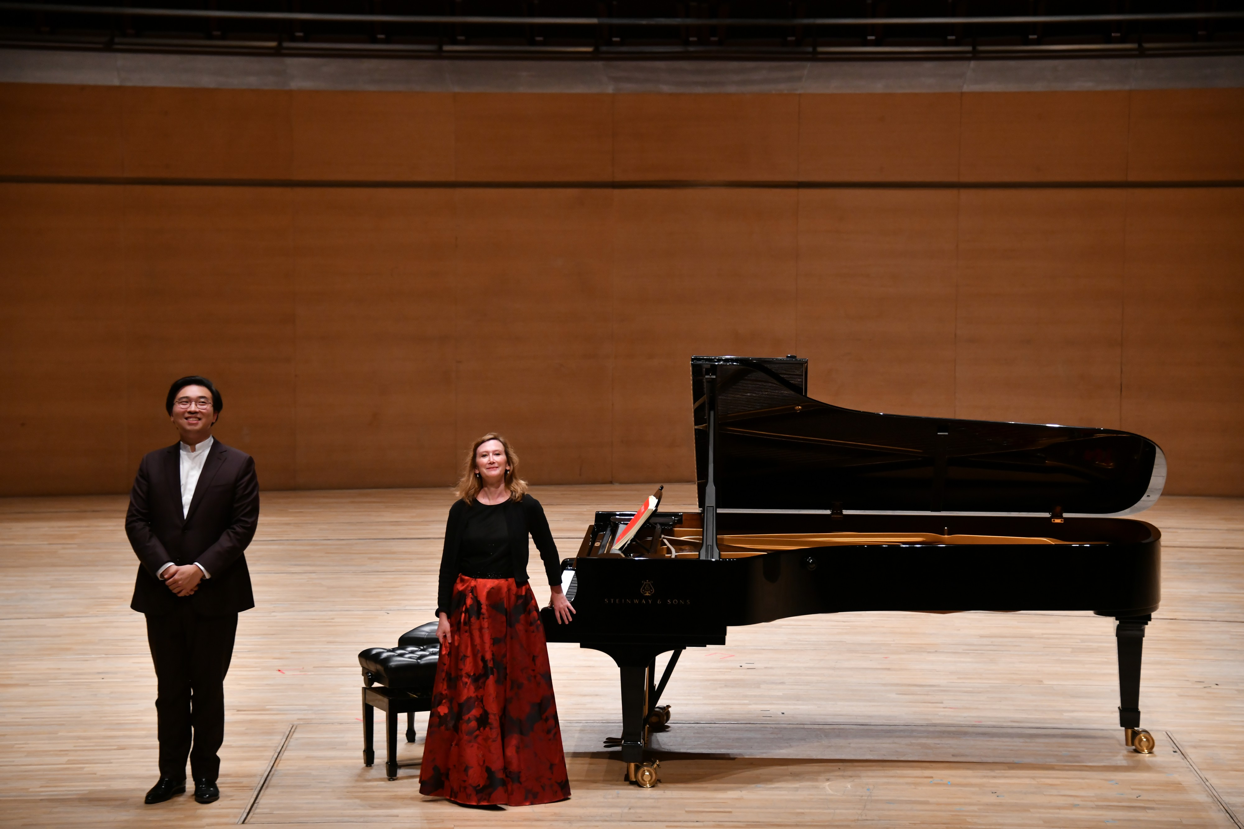 Audrey Axinn with pianist and Tianjin Juilliard resident faculty, Alvin Zhu, performing at The Tianjin Grand Theatre in China. Photo credit: Duan Chao