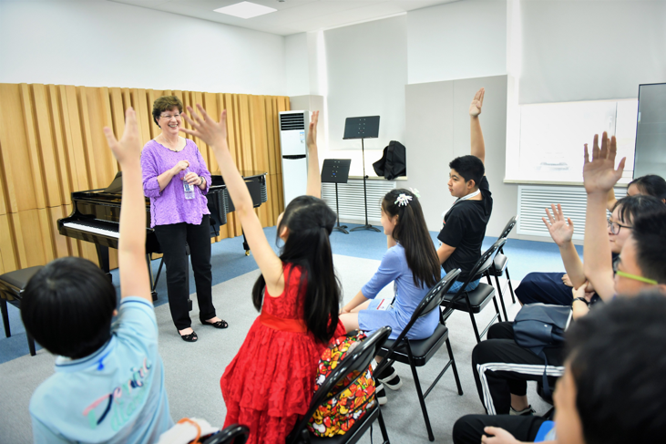 Juilliard's Pre-College artistic director and pianist Yoheved Kaplinsky with the  Tianjin Juilliard Pre-College students in China. Photo credit: Duan Chao